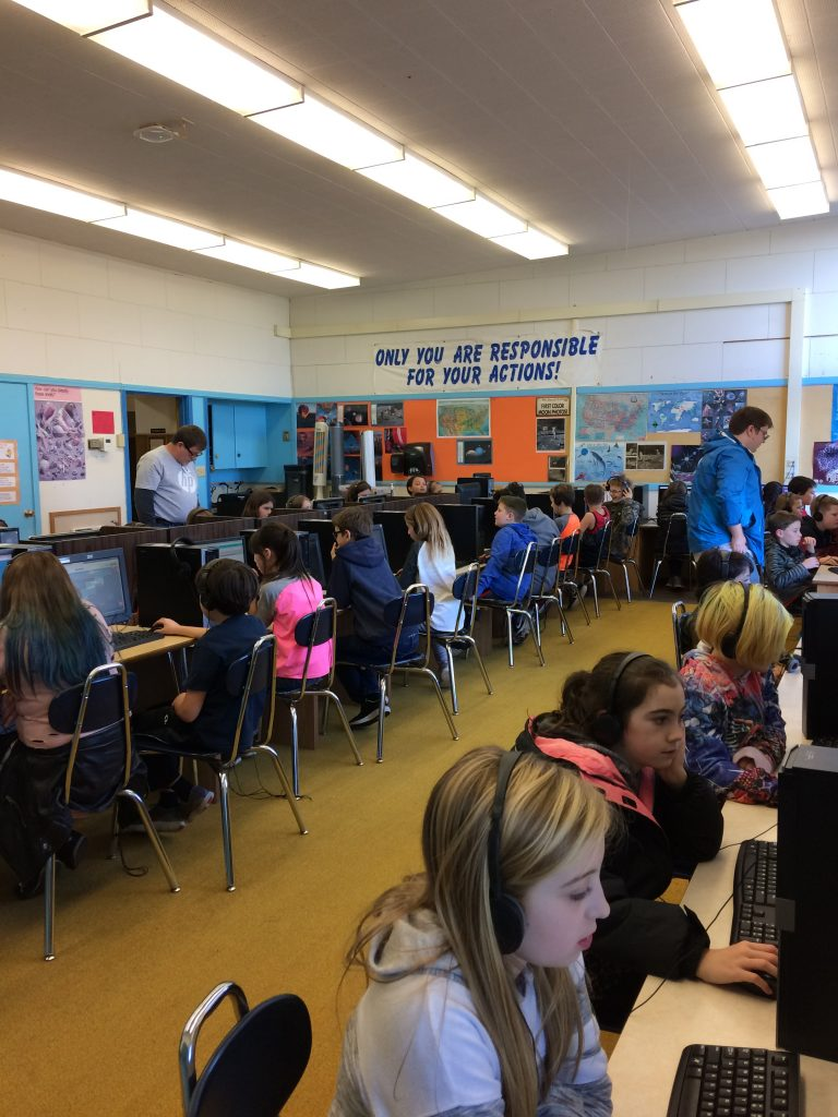 HP volunteers assist students during the Hour of Code.