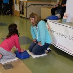 Child Learning CPR