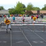 Childen Running Hurdles