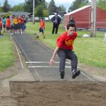 Child doing a long jump