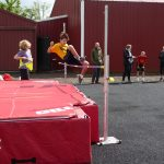 Child doing high jump