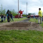 Child doing long jump