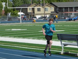 Runners at Middle School Track Meet